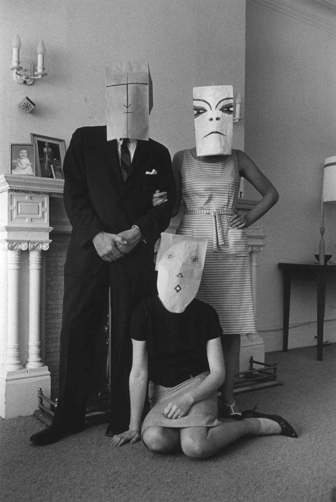 <em>Small Family Group, Chelsea Hotel</em> (from the Mask Series with Saul Steinberg), 1962. Photograph by Inge Morath, © The Inge Morath Foundation