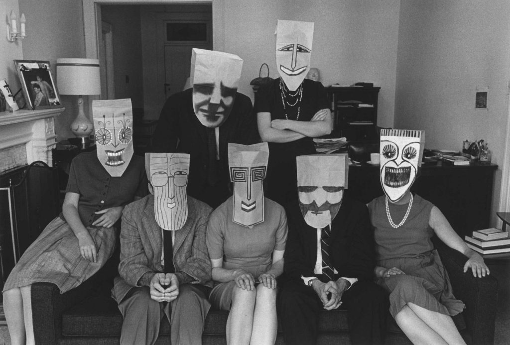 <em>Group Portrait with Masks</em> (from the Mask Series with Saul Steinberg), 1962. Photograph by Inge Morath, © The Inge Morath Foundation